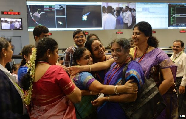 Indian staff from the Indian Space Research Organisation (ISRO) celebrate after the Mars Orbiter Spacecraft (MoM) successfully entered the Mars orbit