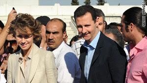 Syrian President Bashar al-Assad (R) and First Lady Asma al-Assad in Damascus on June 30, 2011