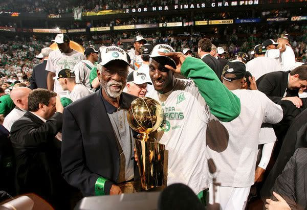 Kevin Garnett and Celtics legend Bill Russell pose with the NBA trophy after Boston wins the championship in Game 6 of the NBA Finals, on June 17, 2008.
