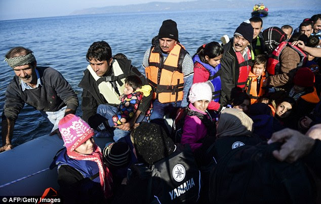 Crossing: Migrants and refugees arrive on the Greek island of Lesbos after crossing the Aegean Sea from Turkey. The EU will discuss redrawing the borders of the Schengen Zone