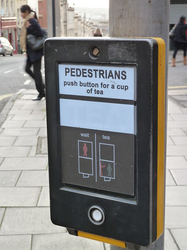 Pedestrians: push button for a cup of tea