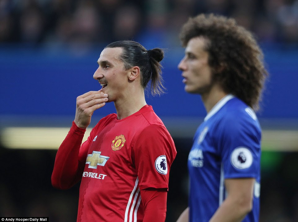 Manchester United's Zlatan Ibrahimovic (left) looks on as the visitors suffer a thrashing by Chelsea