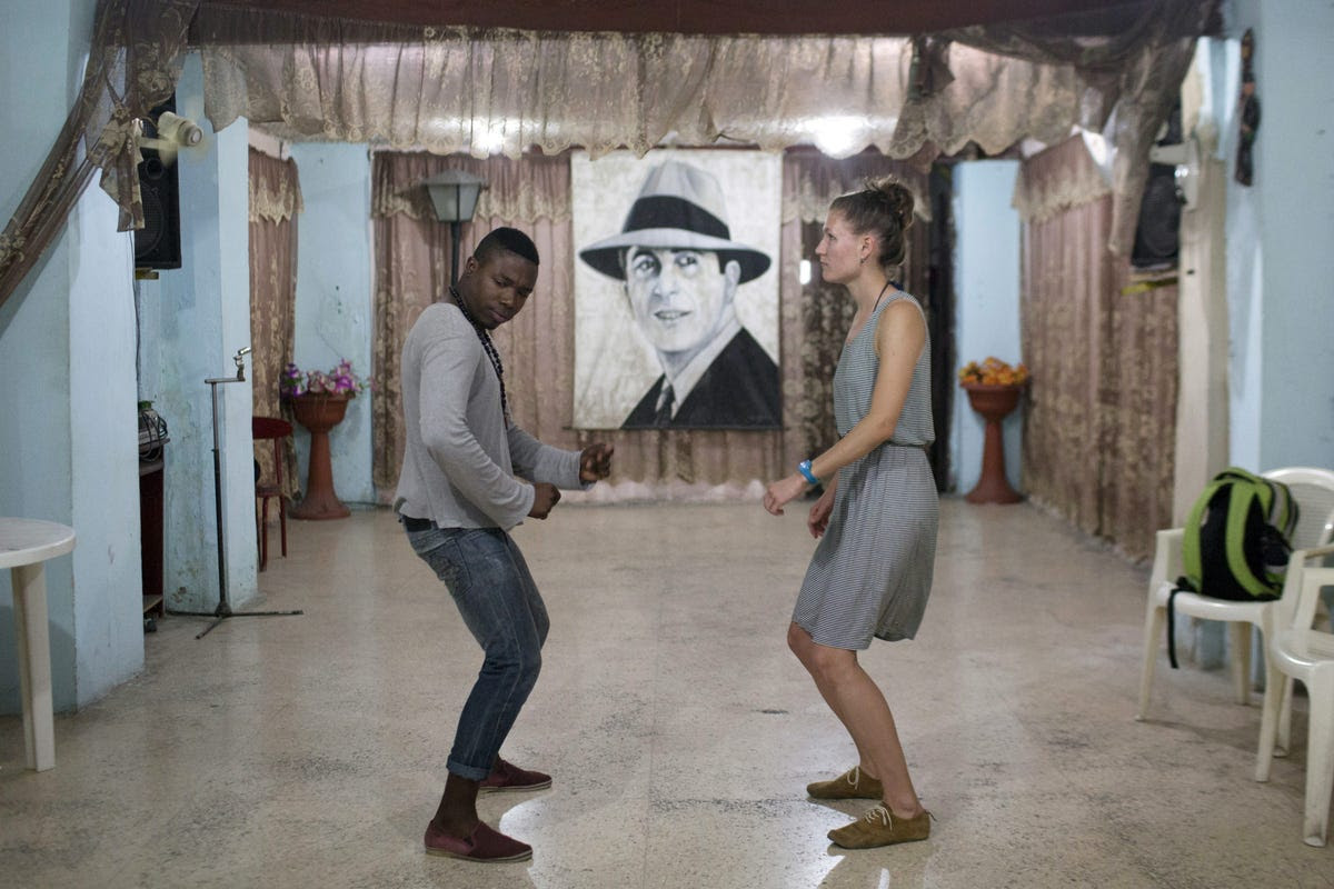 Salsa dance instructor Ariel Domninguez gives a lesson of Cuban-style salsa to a student.
