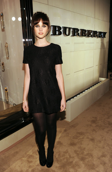 gal in little black dress, black opaques, and black boots