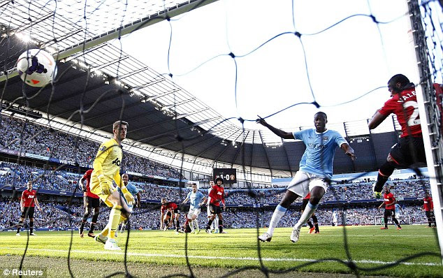Doubling the advantage: Yaya Toure put City 2-0 up in first half stoppage time