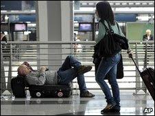 Passengers wait at Milan airport