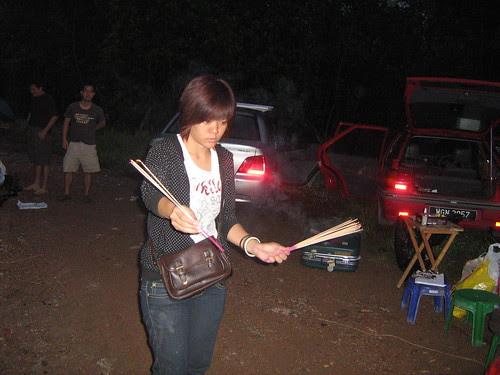Assistant director Khai Sim with joss sticks