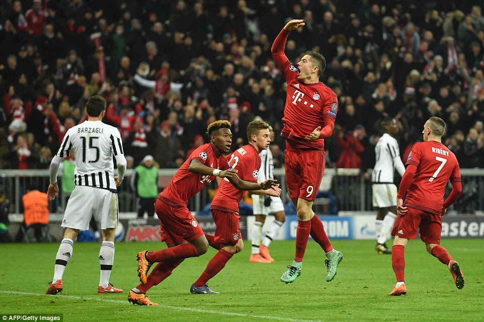 Lewandowski jumps for joy and rallies supporters behind the goal after giving Bayern Munich a lifeline with less than 20 minutes to play