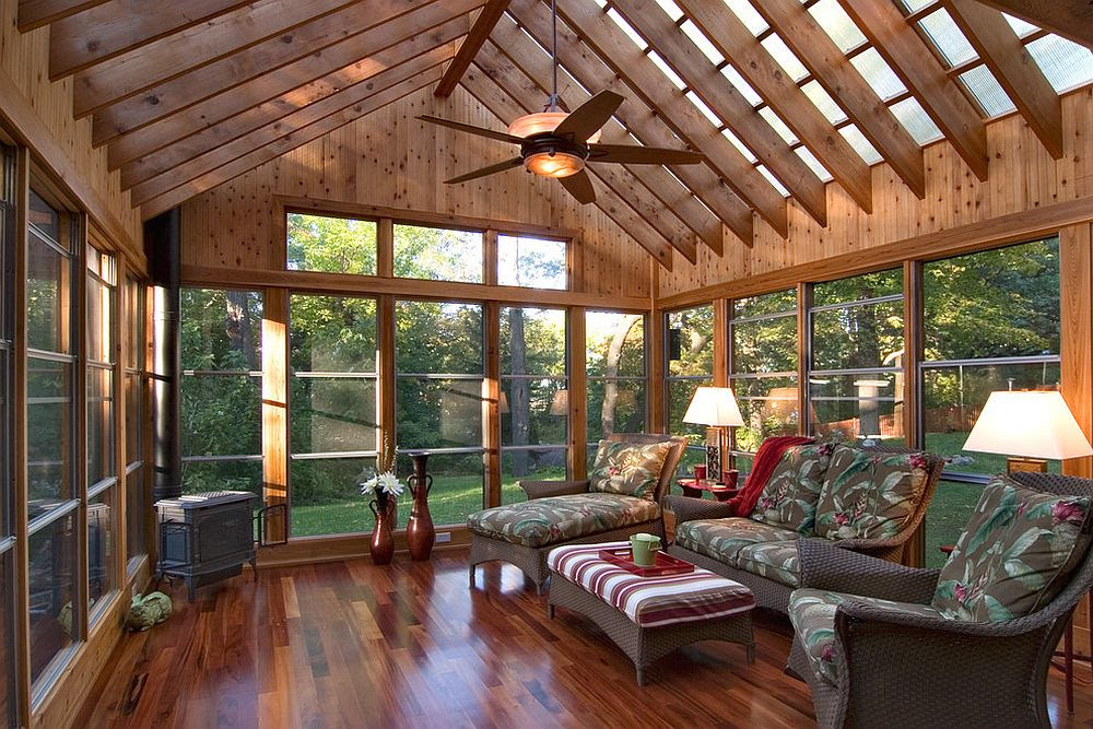 Polycarbonate roof panels flood the sunroom with filtered natural light