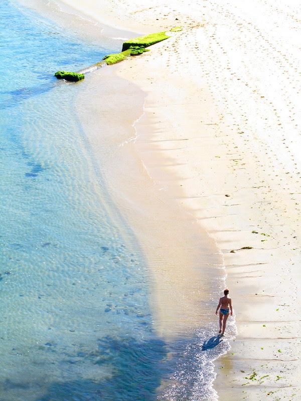 Woman Walks on Beach