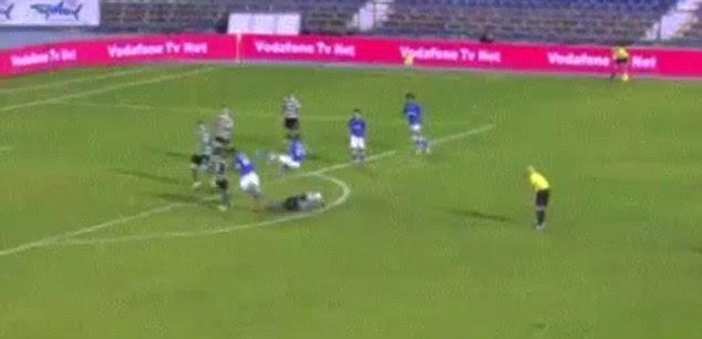 Powerful: The force of Carvalho's challenge sends two Belenenses players into the air