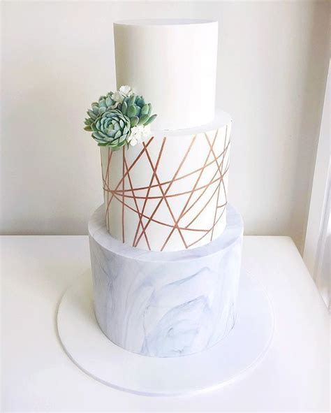A very modern wedding cake composed of marble, geometric