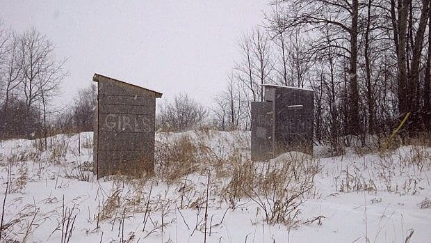 Outhouses near the band office of the Wasagamack First Nation in Manitoba. The outhouses are used year-round, even in the winter. More than 60 per cent of residents in the Cree community 600 kilometres northeast of Winnipeg lack indoor plumbing.