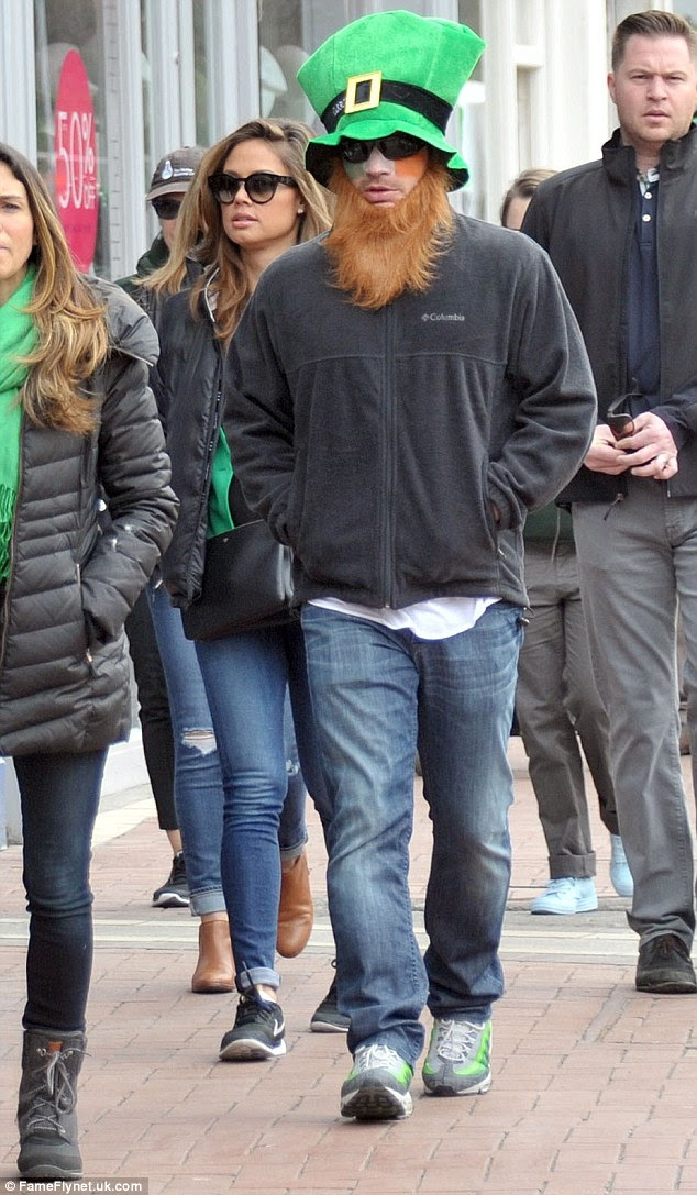 Enjoying the craic: Nick looked game for the festivities as he took to the streets of Dublin