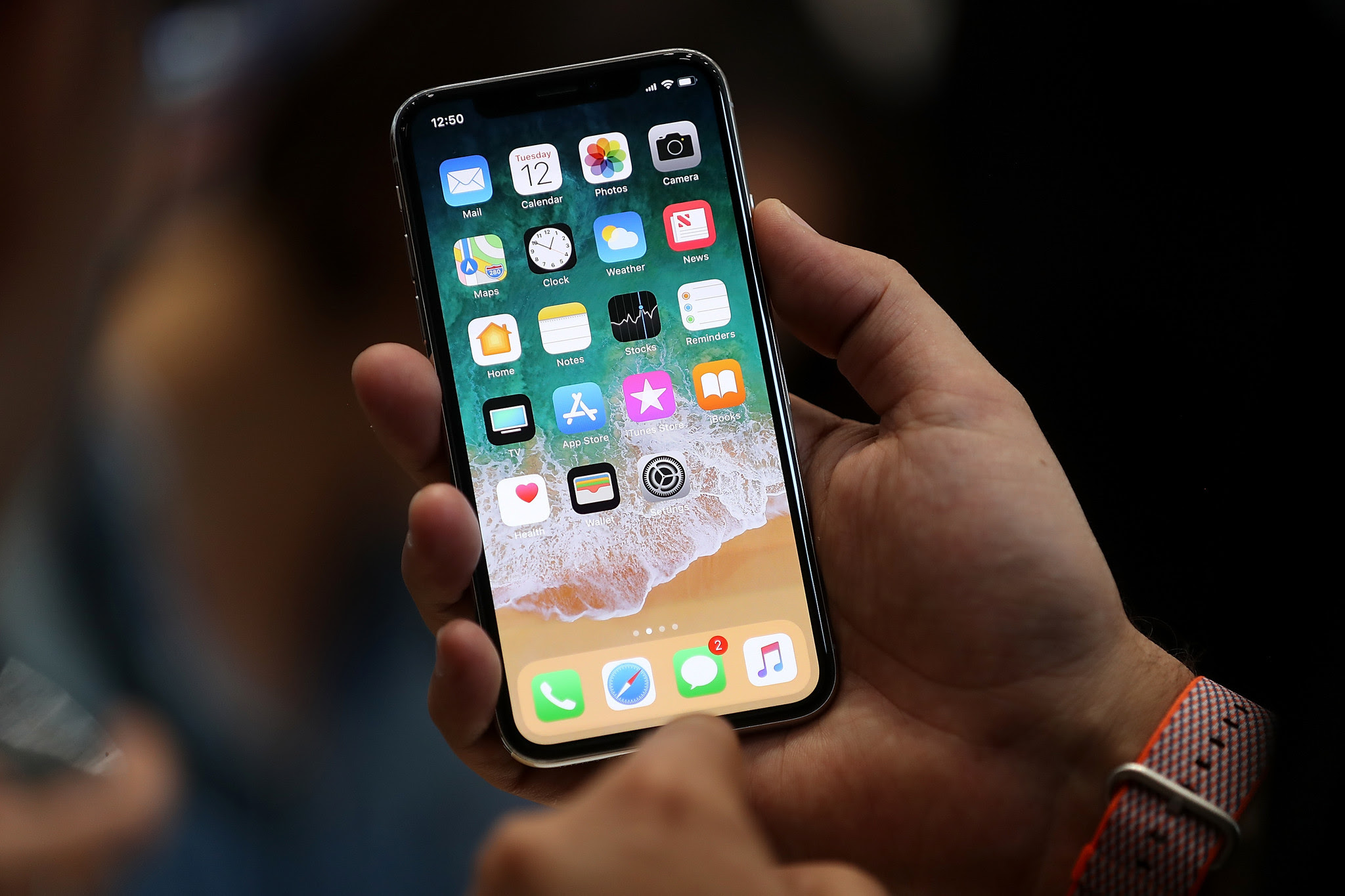 Image result for iphone x on hand
