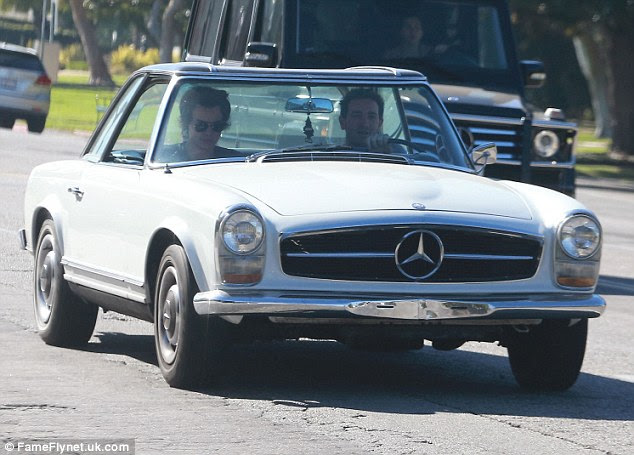 Harry Styles goes cruising in California in white vintage Mercedes ...
