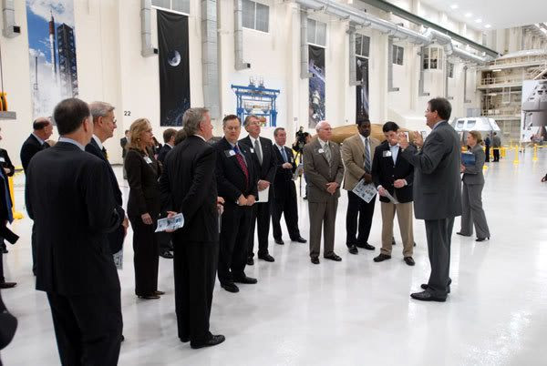 Delegates gather inside the newly-refurbished Operations & Checkout Facility at Kennedy Space Center in Florida.