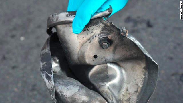 Boston Marathon bomb scene pictures taken by investigators show the remains of an explosive device. The photos were produced by the Joint Terrorism Task Force of Boston and provided to Reuters on April 16 by a U.S. government official who declined to be identified.
