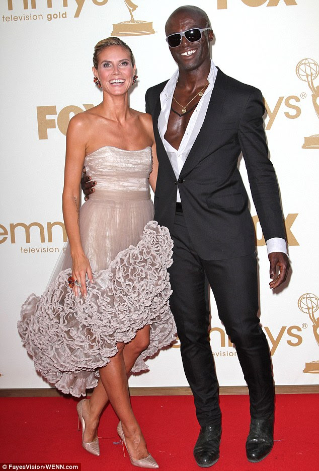 She got the tattoo in commemoration of her 'fourth wedding' with Seal: Heidi Klum, pictured here with Seal in September 2011 when the pair were together, renewed their vows annually