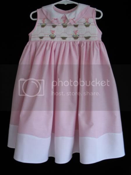 Sophie\'s Easter Dress with a pinstitched Madeira hem and collar and picture smocked baskets.