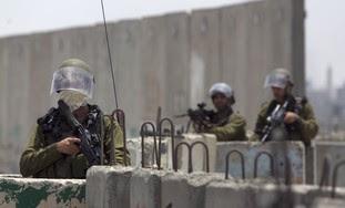 Soldiers at the Kalandiya checkpoint