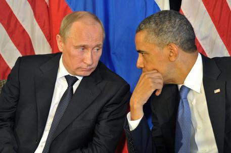 Vladimir Putin e Barack Obama © EPA