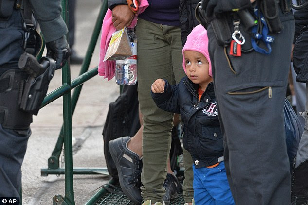 A young refugee waits at the rail station in Freilassing, southern Germany. The country now expects to welcome up to a million newcomers