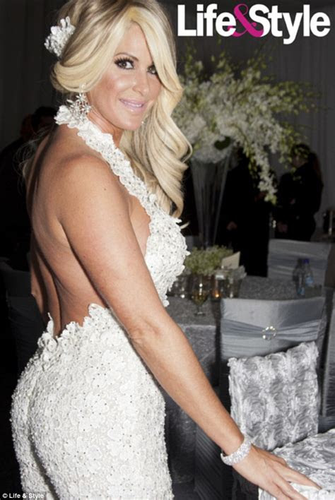 Kim Zolciak wears THREE wedding outfits at $1 million