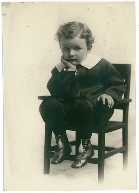 Boy and shoe tassles in a chair