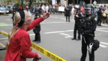 PORTLAND, OR - JUNE 04:  A protester gestures toward police on June 4, 2017 in Portland, Oregon. Pro-President Trump and counter protests are taking place in the wake of the stabbing deaths of Ricky Best, 53, and Taliesin Namkai-Meche, 23, severe injuries to Micah Fletcher,21, after they tried to protect two teenage girls, one of whom was wearing a hijab, from being harassed with racial taunts by suspect Jeremy Christian.  (Photo by Scott Olson/Getty Images)