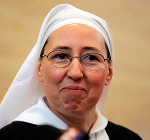 Sister Marie-Simon-Pierre attends a news conference in Aix-en-Provence, France, March 30. The French nun believes that she was healed from Parkinson's disease through the intercession of Pope John Paul II. (CNS/Reuters)