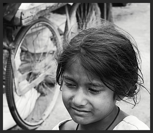 the girl child and the cosmic wheel of violence by firoze shakir photographerno1