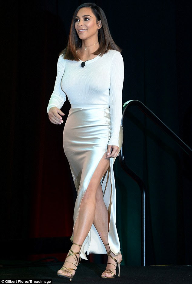 Shimmering, glimmering: As she took the stage, the frequent cover girl's silk dress gleamed under the lights