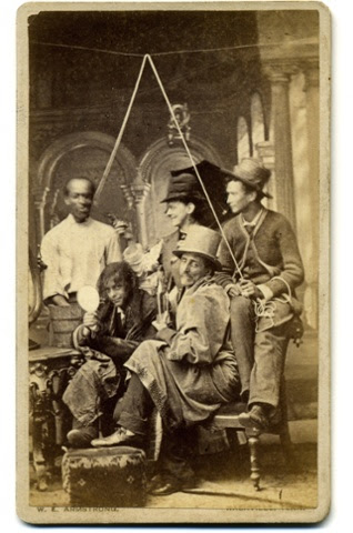 A carte de visite of an amateur theatrical group presenting a mock lynching, c1880