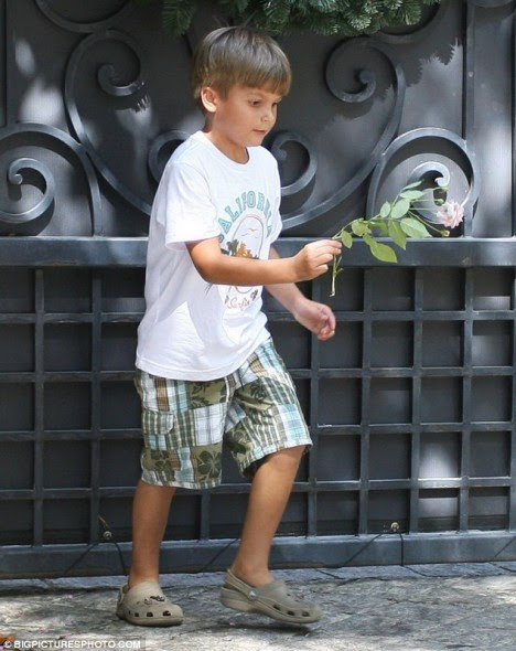 Floral tribute: A young fan lays a flower in memory of Michael Jackson outside the singer's former childhood home