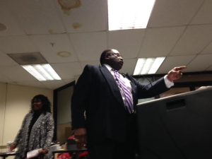 """Rev. John Givens tells the Paterson board: """"Reject this budget!"""""""
