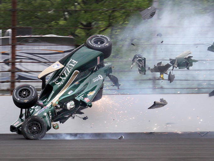 Ed Carpenter (20) of CHF Racing hits the wall coming