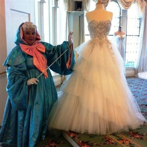 Cinderella's Fairy Godmother with her wedding dress from