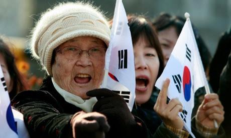 North Korean defectors take part in a anti-North Korea protest in Seoul