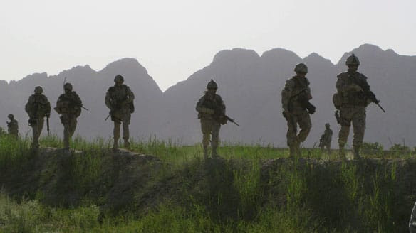 Canadian soldiers patrol an area in the Dand district of southern Afghanistan in June. Canada is denying reports that insurgents were paid off in the war-torn country.