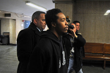 James Dixon, 24, was charged on March 3, 2015 with killing Islan Nettles. He is pictured heading to be arraigned on the indictment in Manhattan Criminal Court.