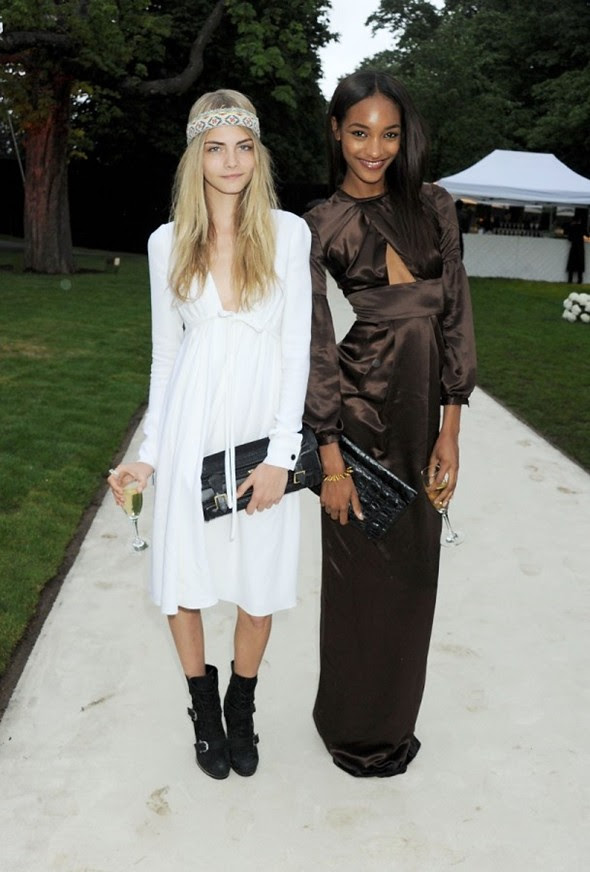 Burberry ad campaign models Cara Delevingne and Jourdan Dunn wearing Burberry at the Burberry Serpentine Summer Party