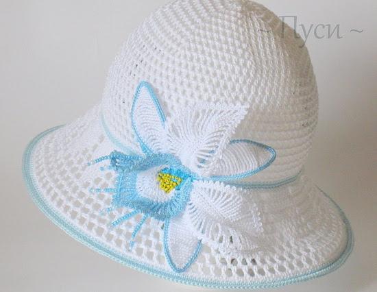 Вязаная шляпа - панама с орхидеей.