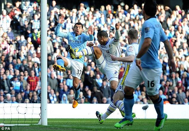 Carlos Tevez scores Man City's third goal