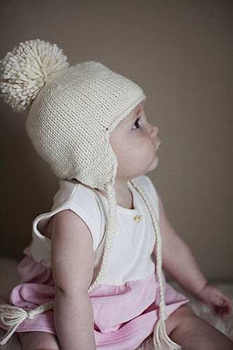 Free knitting pattern for Baby Earflap Hat knit seamlessly with braided ties and optional pompom