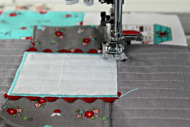 20 Use your machines applique stitch or zig zag stitch to sew the windows and door in place