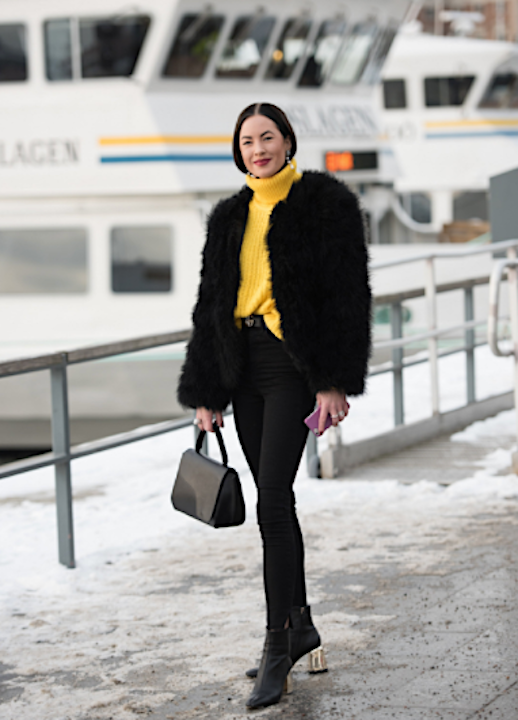 Le Fashion Blog Fashion Week Street Style Black Fur Coat Yellow Turtleneck Sweater Black Skinny Jeans Black Gold Heel Boots Via Vogue