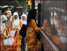Malay students board the bus at Universiti Malaya in Selangor