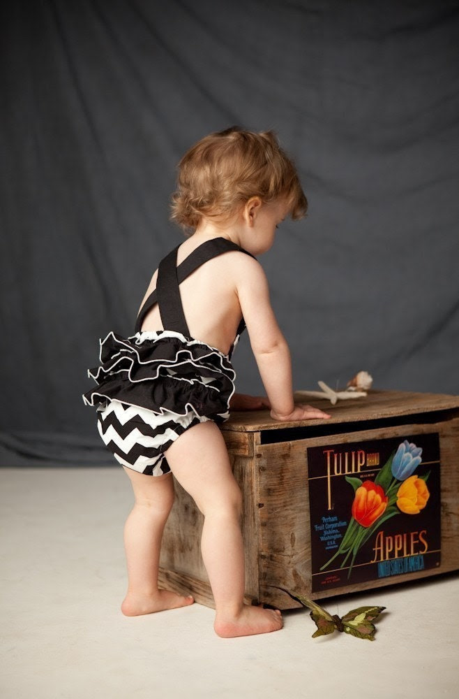 Black and white chevron stripe vintage-inspired sun suit romper, with black ruffles, for your tiny rockabilly hipster