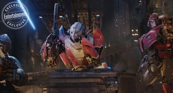 A screenshot of Arcee, Brawn and a fellow Autobot ready to battle the Decepticons (off-screen) on Cybertron...in BUMBLEBEE.
